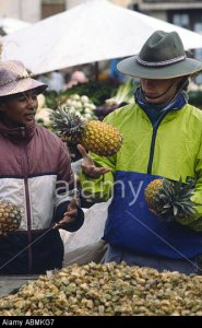 PICTURE CREDIT DOUG BLANE Sean OKelly buying a pineapple in zoma market Antanarivo Madagascar