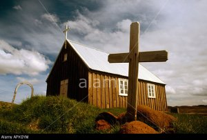PICTURE CREDIT DOUG BLANE Cross small Church perched on the edge of a lava plain at Krysuvik Iceland