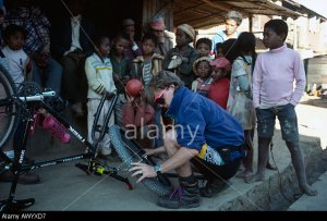 Sean O'Kelly mending a puncture on his mountain bike during the Tran-Madagascan Mountain Biking Expedition