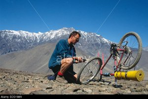 Doug Blane mountain biking around the Annapurna circuit in Himalayan Kingdom of Nepal Nepalese Himalayas